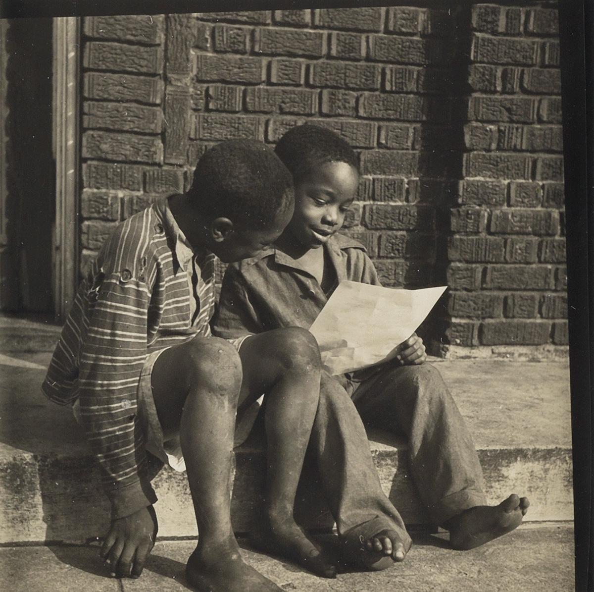 GORDON PARKS (1912-2006) Two boys reading.