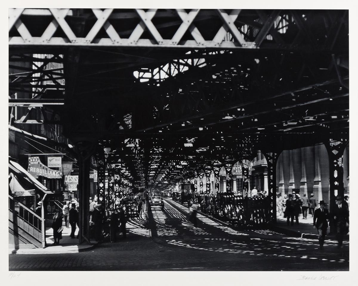 Abbott, Berenice (1898-1991) Under the El at the Battery, Manhattan, 1936.