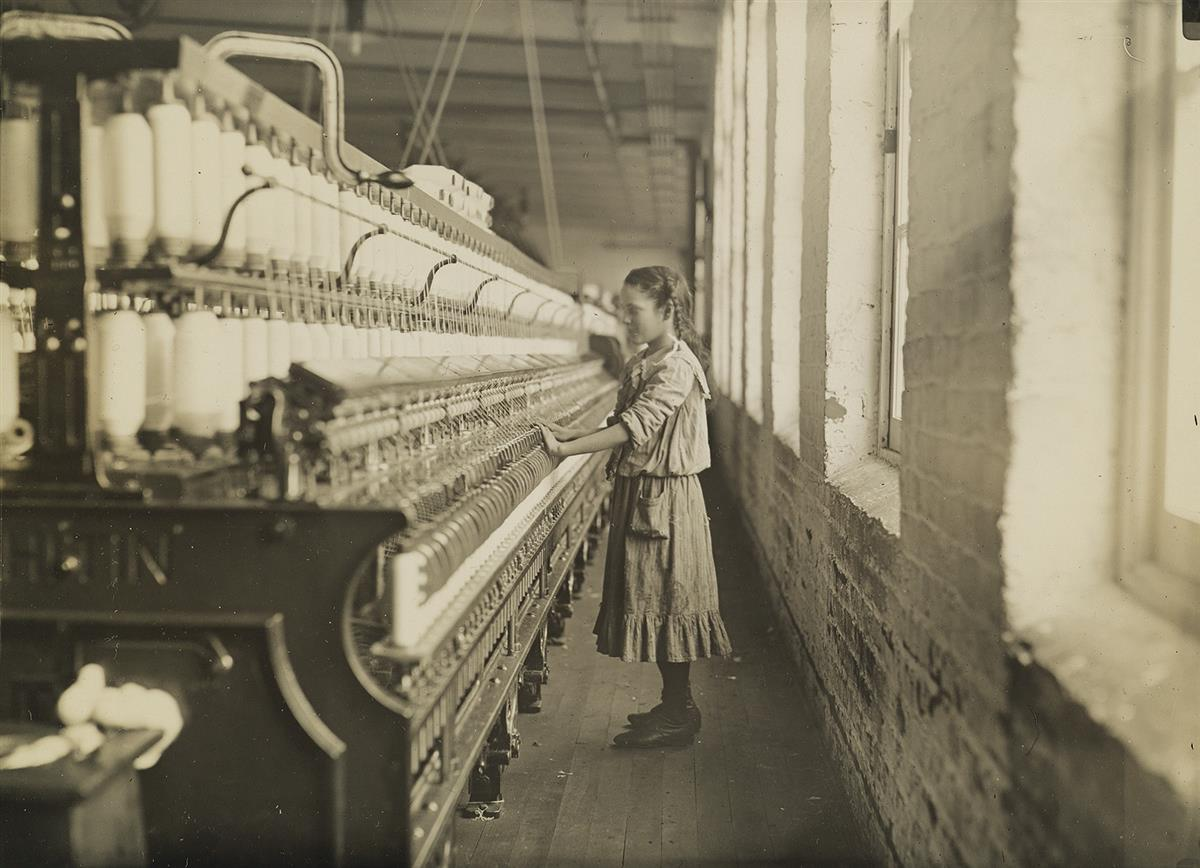 LEWIS W. HINE (1874-1940) Spinner in Carolina cotton mill.