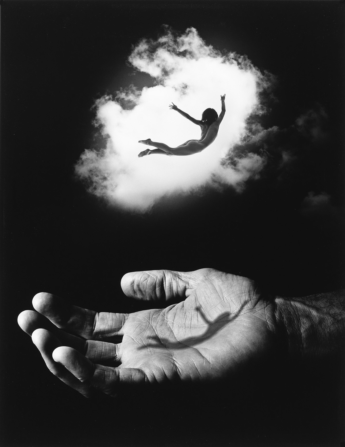JERRY-UELSMANN-(1934--)-Untitled-(hand-and-flying-figure)