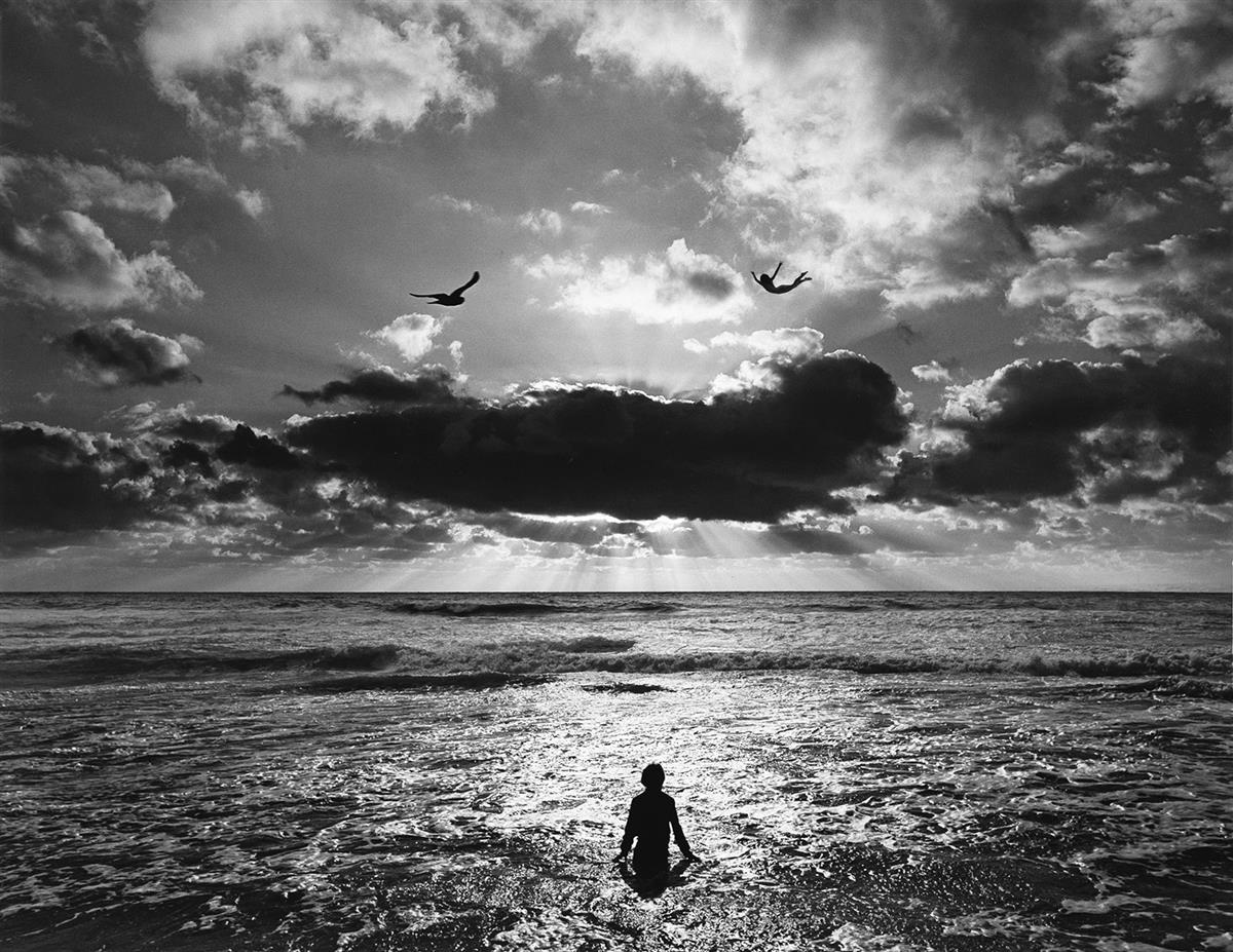 JERRY-UELSMANN-(1934--)-Untitled-(beach-scene-with-flying-fi