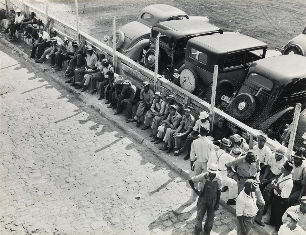 (DOROTHEA LANGE) (1895-1965) Part of the daily lineup outside the State Employment Service Office, Memphis, Tennessee.