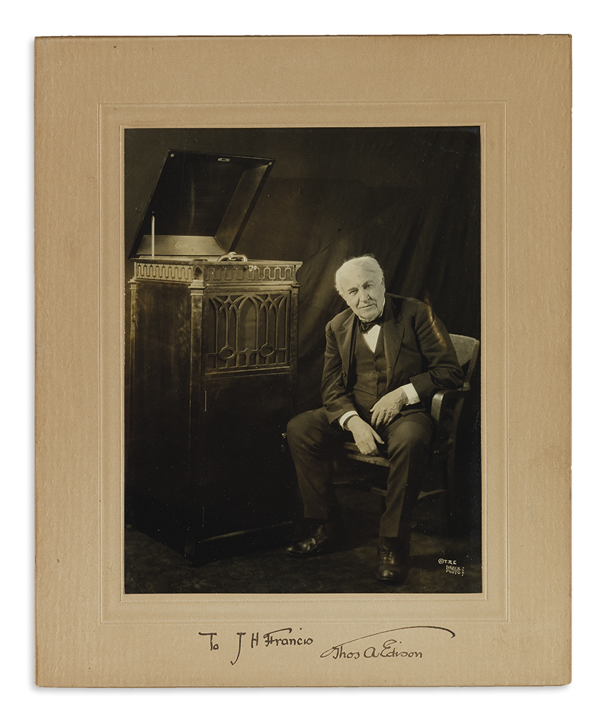 EDISON, THOMAS A. Photograph Signed and Inscribed, To J.H. Francis, full-length seated portrait by Lueder, showing him beside a phono