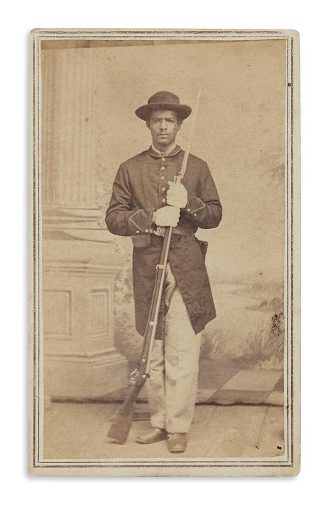(MILITARY--CIVIL WAR.) Full-length carte-de-visite studio portrait of an African-American soldier.