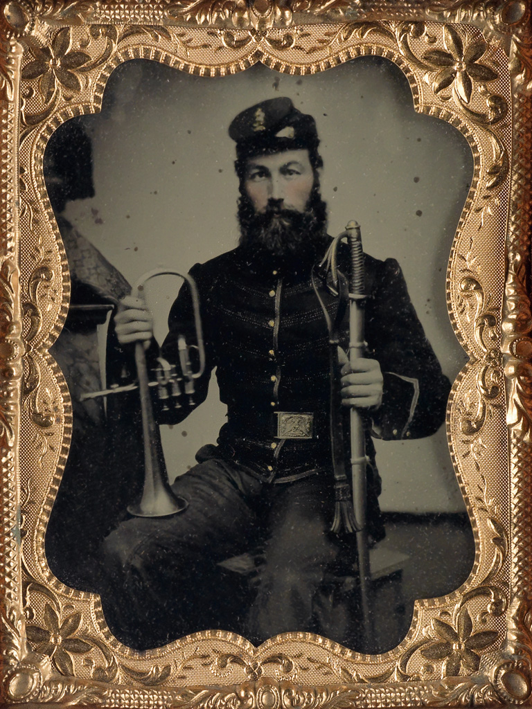 (CIVIL WAR) Group of 23 Civil War-era tintypes and an ambrotype depicting Union soldiers proudly posing with a host of weapons.