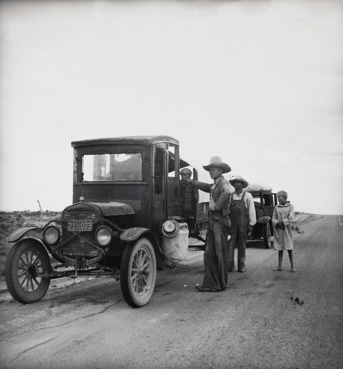 DOROTHEA LANGE (1895-1965) Drought refugees stopped along highway.