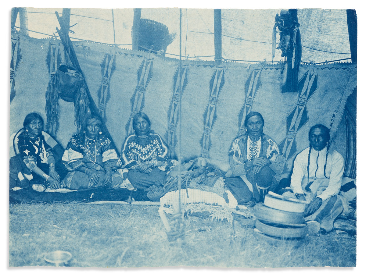 (AMERICAN INDIANS--PHOTOGRAPHS.) Edward S. Curtis. Unpublished cyanotype of five men in a Piegan lodge.