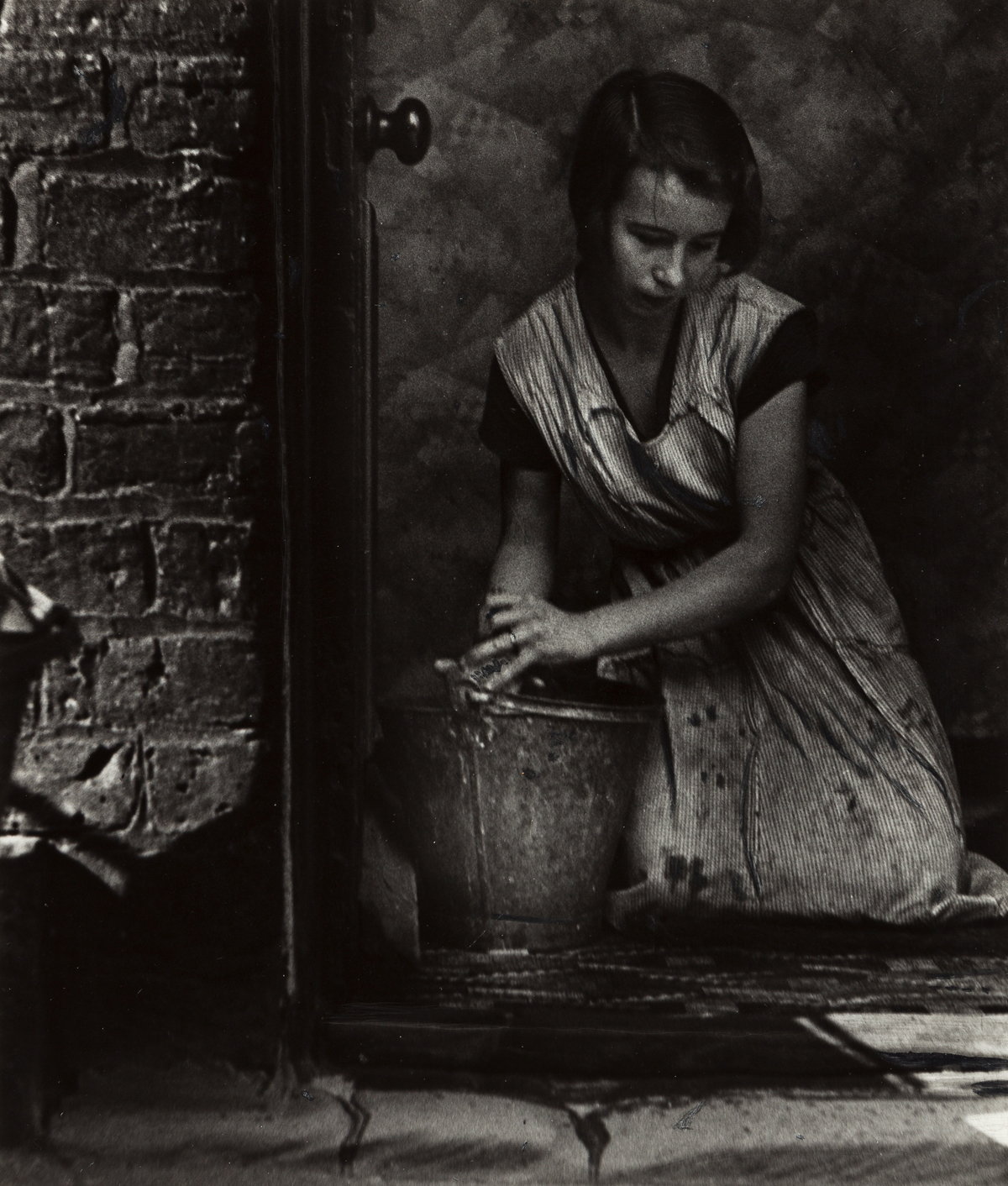 BILL BRANDT (1904-1983) Young housewife, Bethnal Green, London.