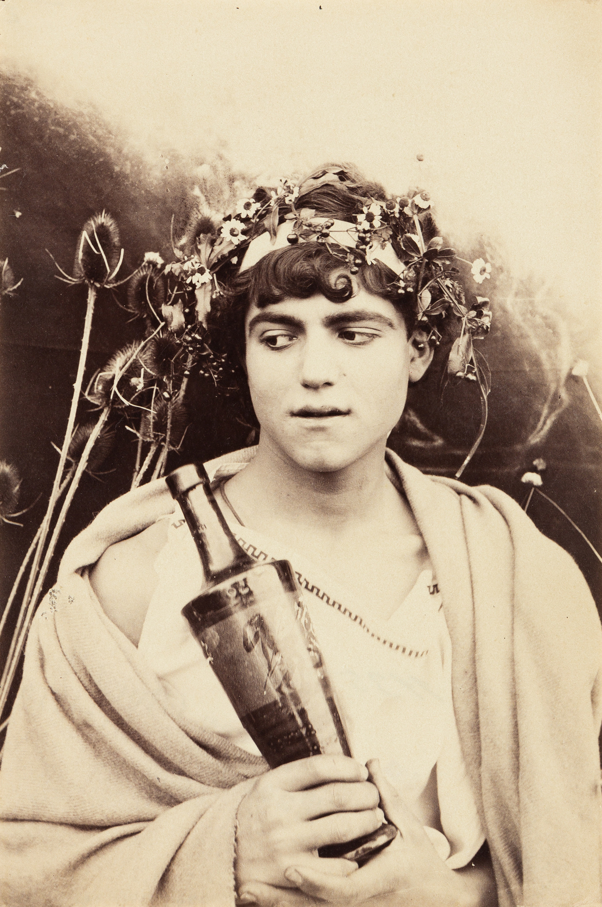 WILHELM VON GLOEDEN (1856-1931) Boy wearing a toga.