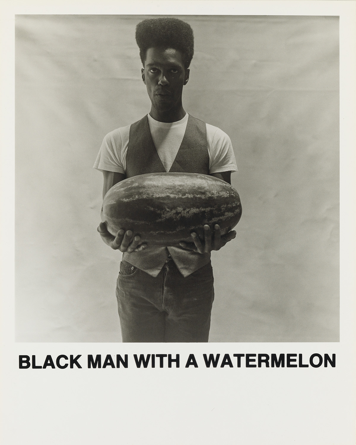 CARRIE-MAE-WEEMS-(1953-----)-Black-Man-With-A-Watermelon