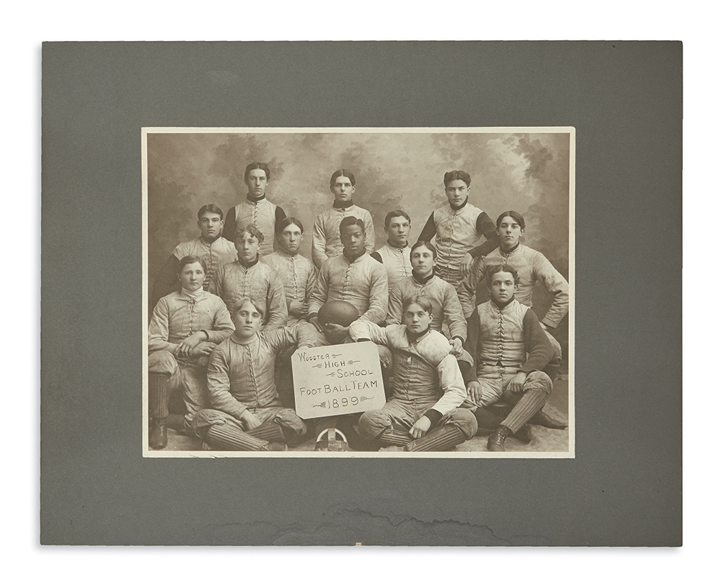 (SPORTS--FOOTBALL.) Team photograph of the Wooster High School football team featuring pioneer athlete Charles W. Follis.