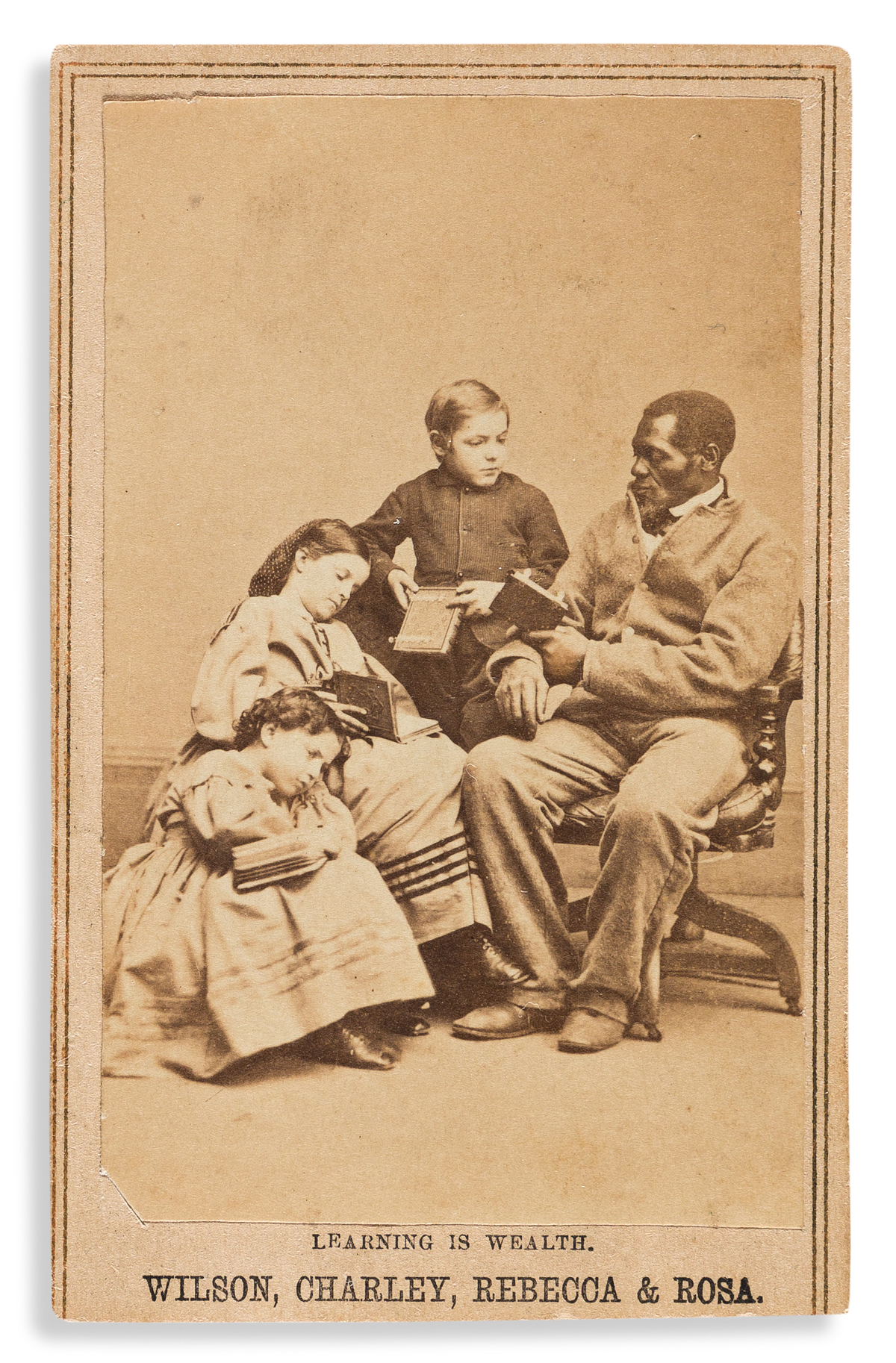 (SLAVERY AND ABOLITION.) Charles Paxson; photographer. Learning is Wealth: Wilson, Charley, Rebecca & Rosa, Slaves from New Orleans.