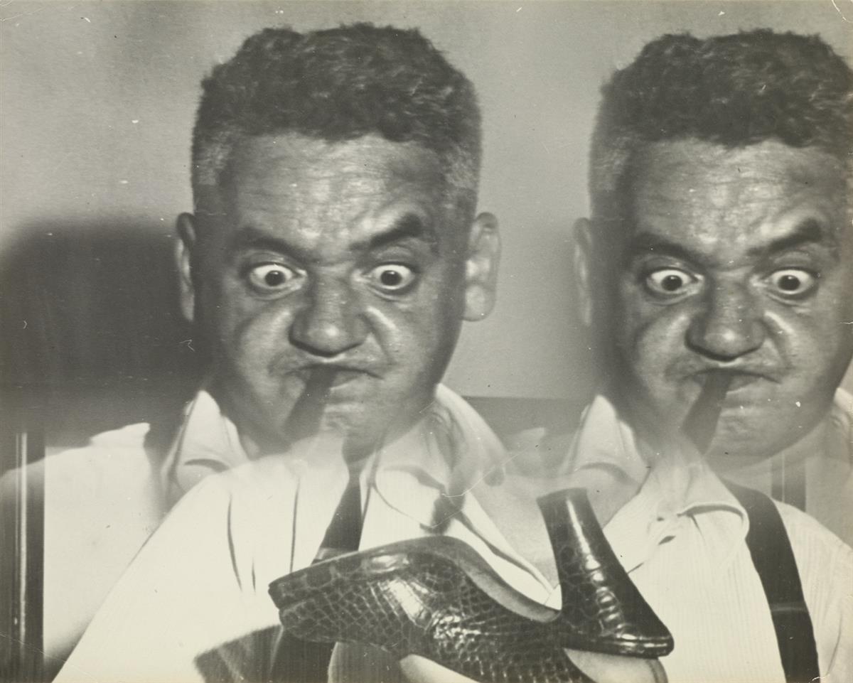 WEEGEE [ARTHUR FELLIG] (1899-1968) Distortion (double self-portrait with womans shoe).