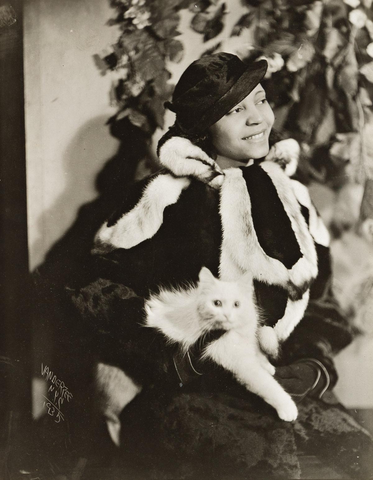 JAMES VANDERZEE (1886 - 1983) Untitled (Woman in Fur Holding Cat).