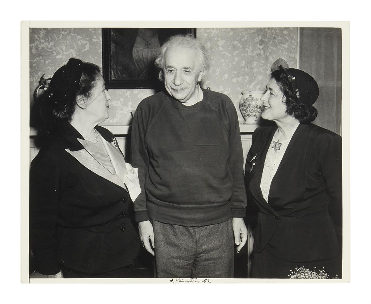 (SCIENTISTS.) EINSTEIN, ALBERT. Photograph Signed, A. Einstein. 52, half-length group portrait showing him standing between Talmudic