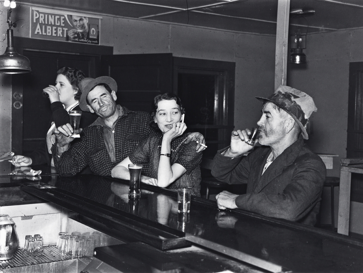 RUSSELL LEE (1903-1986) Saturday night in a saloon, Craigville, Minnesota * Farm Family after evening meal, Pie Town, New Mexico * Wome