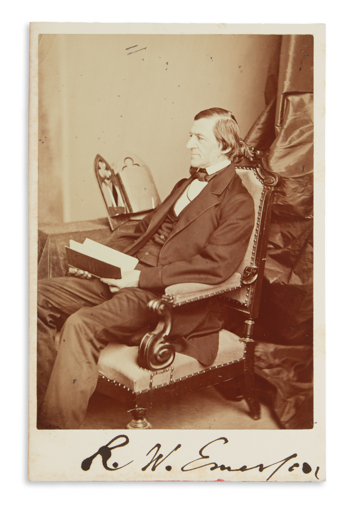RALPH WALDO EMERSON. Photograph Signed, R.W. Emerson, ¾-length seated cabinet card portrait by Notman, showing...