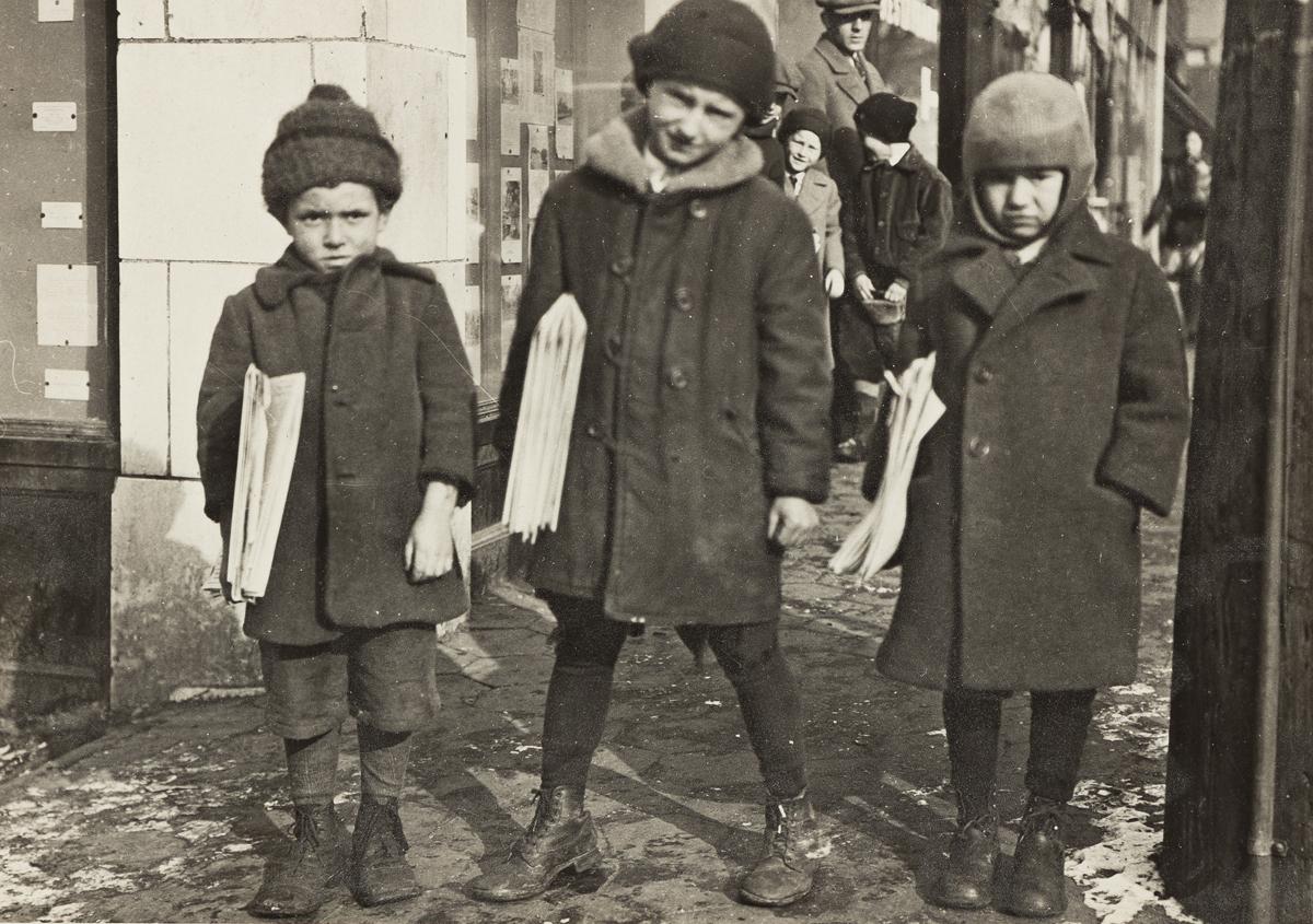LEWIS W. HINE (1874-1940) Three newsboys.