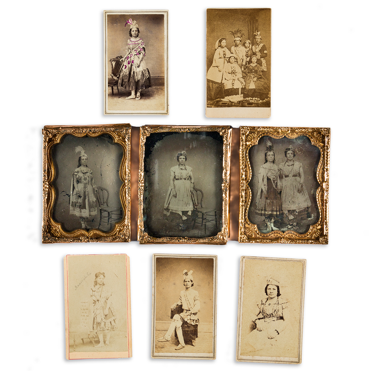 (AMERICAN-INDIANS--PHOTOGRAPHS)-Group-of-8-photographs-of-a-performing-troupe-in-New-York-and-Canada