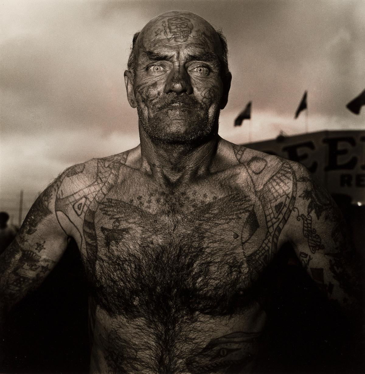 DIANE ARBUS (1923-1971)/NEIL SELKIRK (1947- ) Tattooed man at a Carnival, M.D.