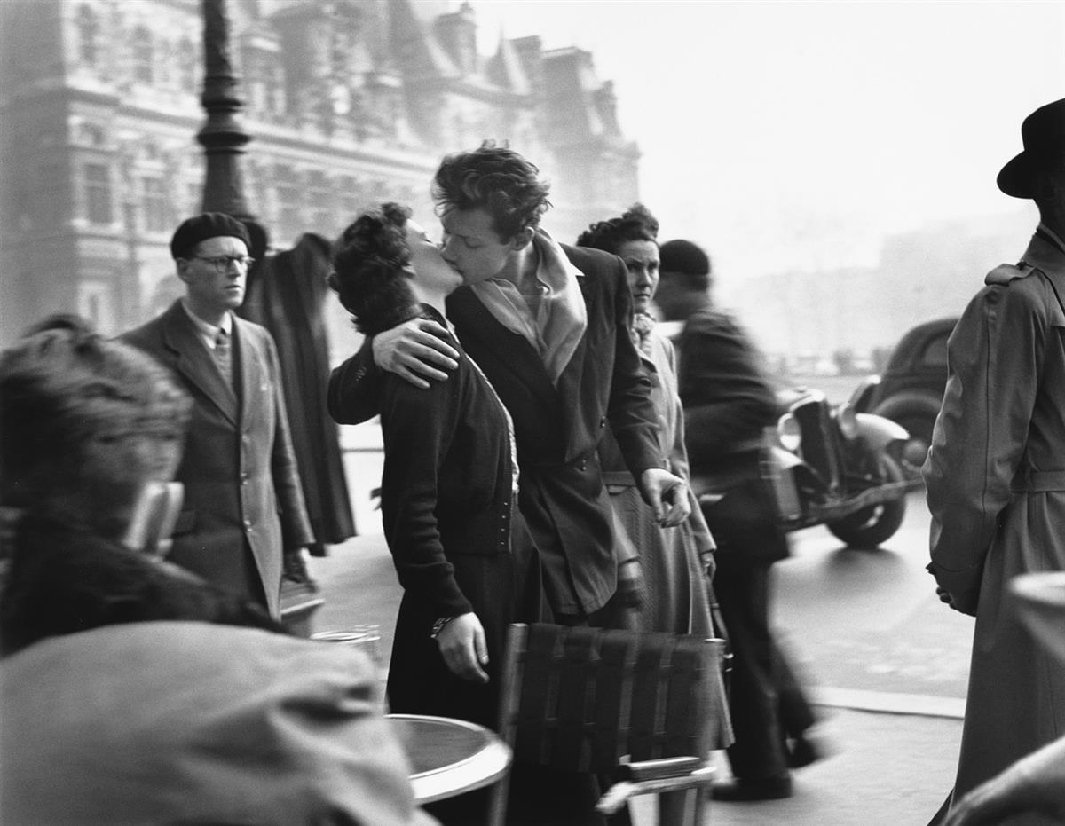 ROBERT DOISNEAU (1912-1994) Le Baiser de lHotel de Ville, Paris [The Kiss at the Hotel de Ville, Paris].