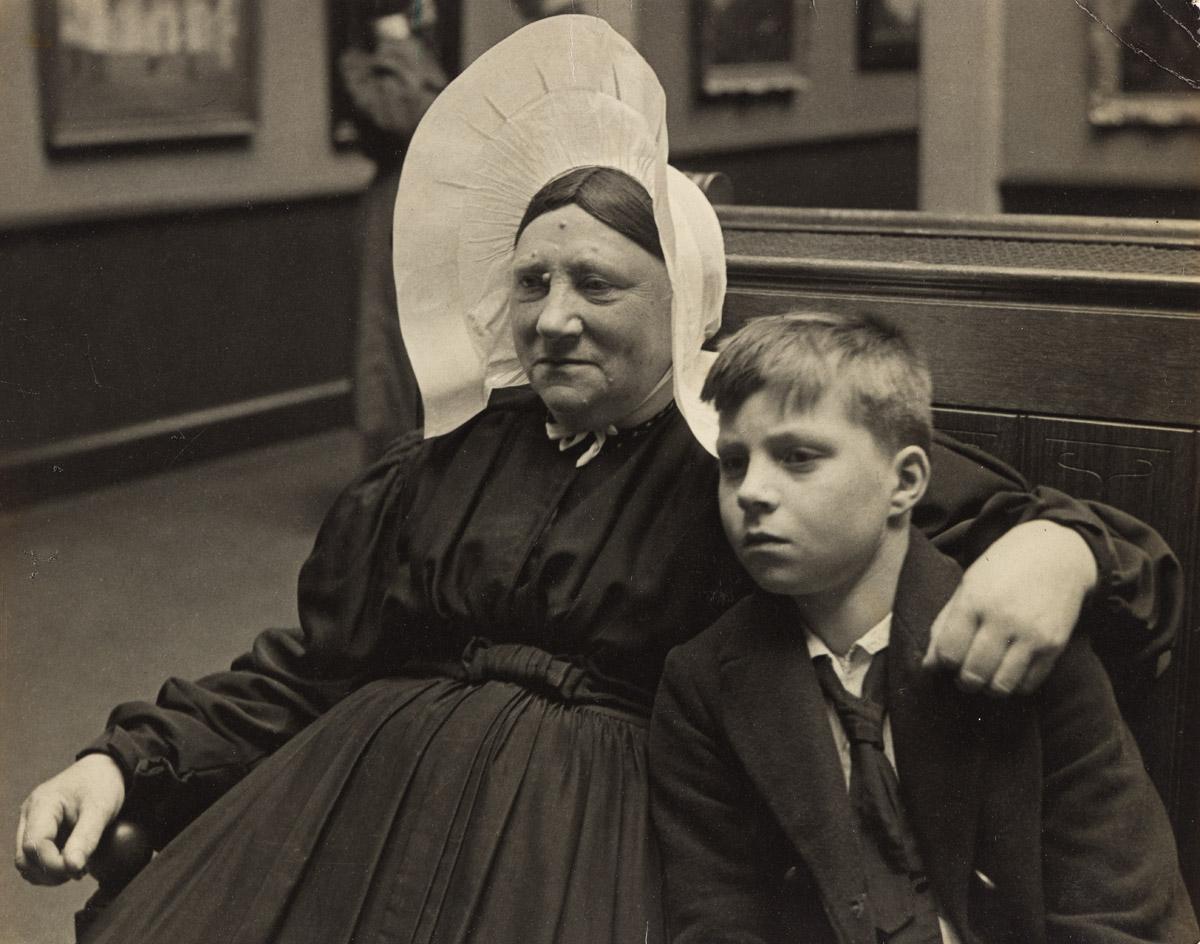 ALFRED EISENSTAEDT (1898-1995) Woman and Grandson Viewing Rembrandts Night Watch, Rijksmuseum, Amsterdam.