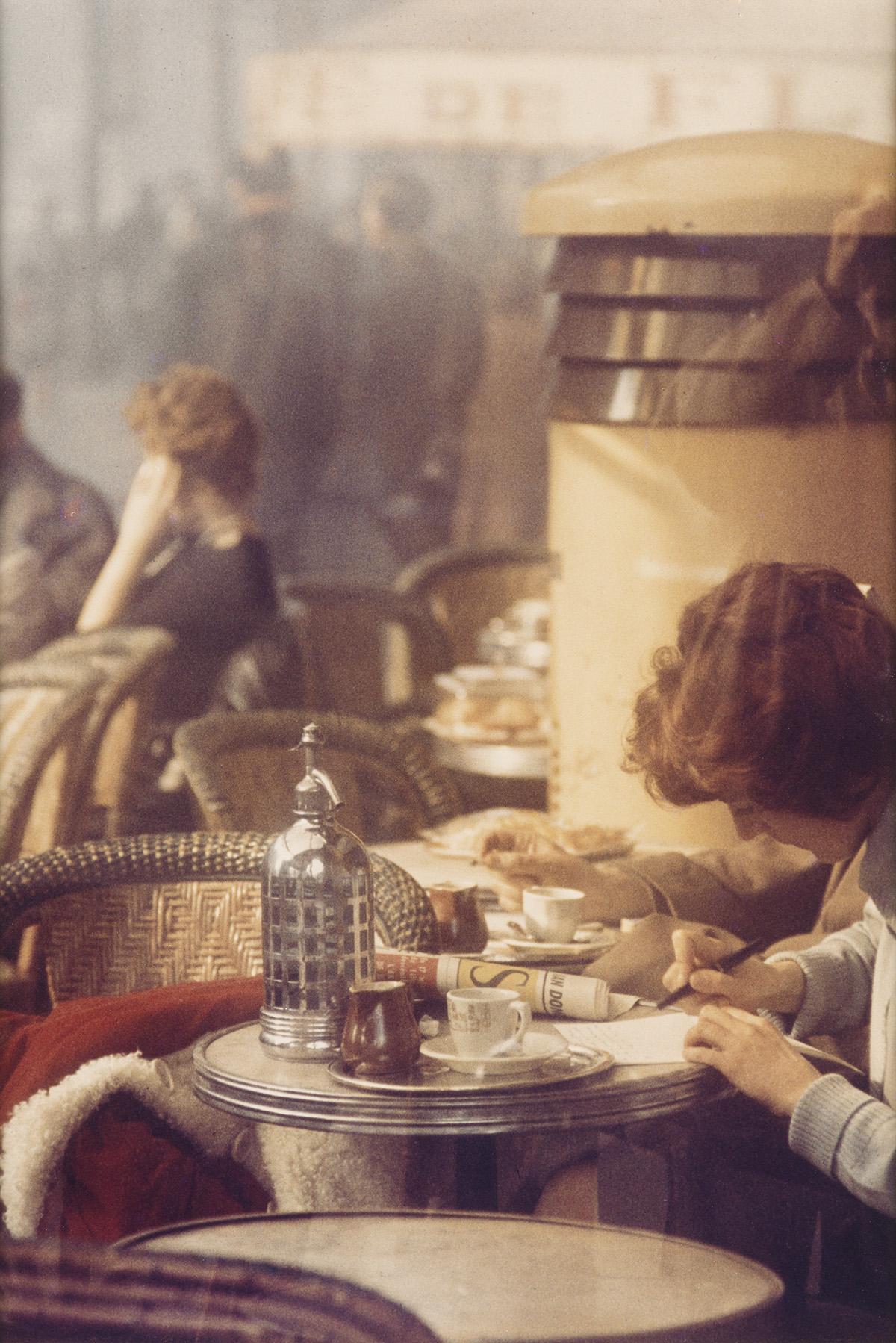 SAUL LEITER (1923-2013) Paris (woman at a café).