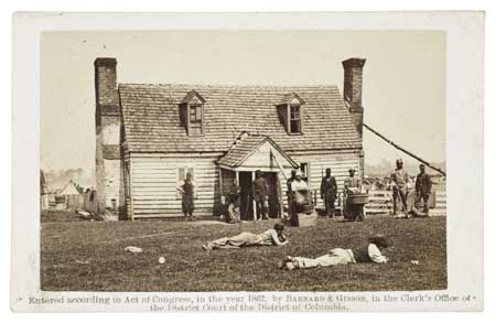 (SLAVERY AND ABOLITION--PHOTOGRAPHY.) Group of Contrabands in front of Allen's Farmhouse near Williamsburg Road (supplied title.)