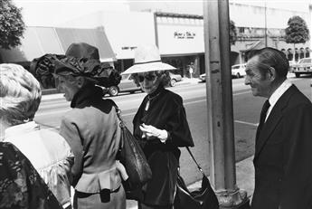 GARRY WINOGRAND (1928-1984) A group of 13 select photographs depicting street scenes in Californa, New York, and Texas.