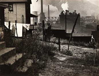 WALKER EVANS (1903-1975) Houses near a steel mill (Bethlehem, PA).