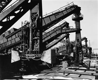 (INDUSTRY) A striking, arty group of 12 dramatic photographs of industrial scenes by Gordon Coster, Arnold Eagle, Ansel Adams, and othe