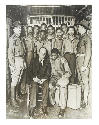 SCOTTSBORO BOYS. Group of eight original press photographs of the Scottsboro Boys, and people associated with their case.