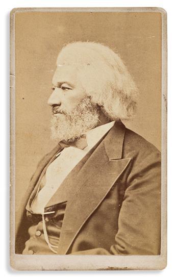 (FREDERICK DOUGLASS.) Samuel M. Fassett, photographer. Scarce carte de visite portrait of Douglass, with his signature on verso.
