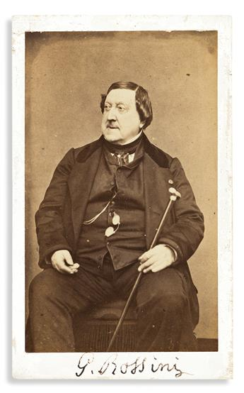 """ROSSINI, GIOACCHINO. Photograph Inscribed and Signed, """"G. Rossini"""" twice, carte de visite, half-length portrait showing him seated."""