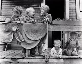 RUSSELL LEE (1903-1986) Christmas dinner, Smithfield, Iowa * Children of the Coal Miners, Appalachia * Coal Miners Children at Home, A