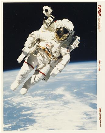 (NASA--SPACE EXPLORATION) An expansive archive with 350 photographs chronicling the wealth of outerspace missions and lunar exploration