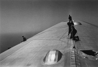 ALFRED EISENSTAEDT (1898-1995) Repairing the Hull of the Graf Zeppelin during the Flight over the Atlantic.