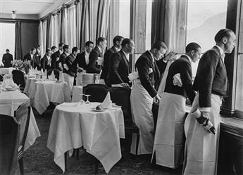 ALFRED EISENSTAEDT (1898-1995) Waiters watching Sonie Heine skate, Grand Hotel Dining Room, St. Moritz, Switzerland.