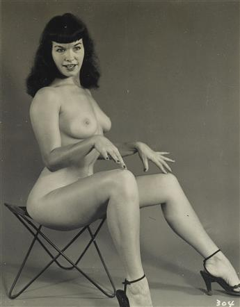 (BETTIE PAGE) A selection of 40 photographs of the Queen of Pinups, comprising 36 vintage photographs, many depicting bondage scenes, a