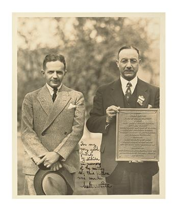 (CIVIL RIGHTS.) WHITE, WALTER F. Inscribed and signed photograph of Walter White presiding at the ceremony for the unveiling of the Joh
