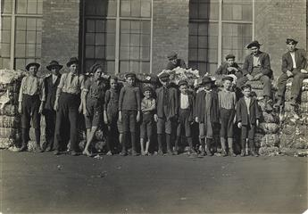LEWIS W. HINE (1874-1940) Group of boys working in Lancaster, S.C. Cotton Mills. Smallest boy in middle said has been in the mill off a