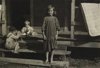 LEWIS W. HINE (1874-1940) Ollie Johnson * 10 year old leaf boy and three stringers, 10, 12, and 13 yrs old. Tobacco shed of American