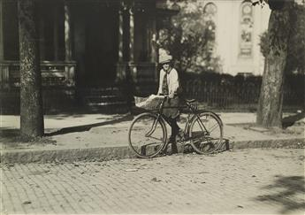 LEWIS W. HINE (1874-1940) A 12 year old delivery boy for a Montgomery laundry. Makes $1.50 a week. Montgomery, Ala.