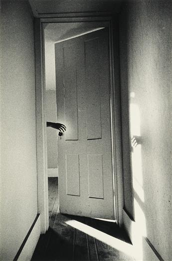 RALPH GIBSON (1939- ) Hand Through Door, from The Somnambulist.