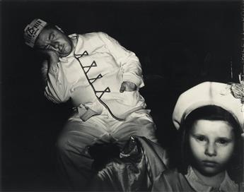 WEEGEE [ARTHUR FELLIG] (1899-1968) Tired Businessman at the Circus.