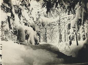 WILSON A. 'SNOWFLAKE' BENTLEY (1865-1931) Group of 4 photographs, comprising two snowy landscapes and a pair of cloud studies.