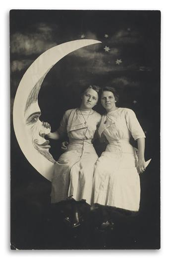 (PAPER MOONS) A magnificent collection of 30 paper moon real photo postcards featuring an array of charmingly posed sitters, perched