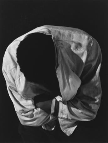ROY DECARAVA (1919-2009) Boy with bowed head.