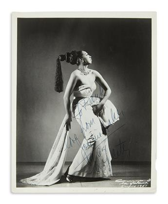 BAKER, JOSEPHINE. Photograph Signed and Inscribed, To Frank / love from / Josephine Baker / 1946 / NY City, full-length portrait