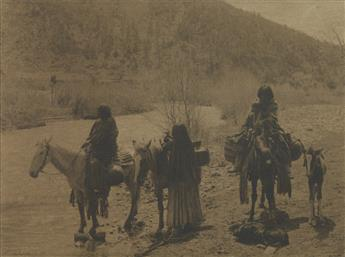 EDWARD S. CURTIS (1868-1952) Native American figures on horseback, with a dog and pony.